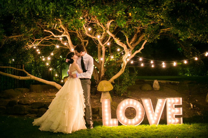 marquee letters bride groom kissing